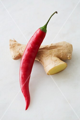 A chili pepper and ginger root