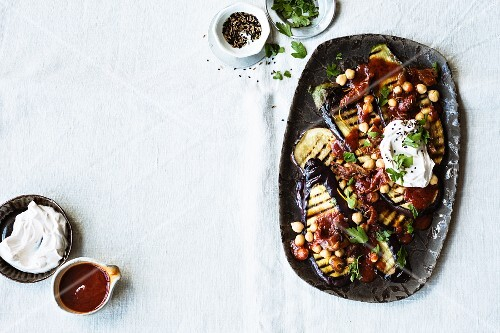Aubergine salad with dried tomatoes, chickpeas and dates