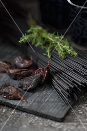 Black spaghetti coloured with coal (edible coal from Japan, for vegetarians), rosemary and black garlic