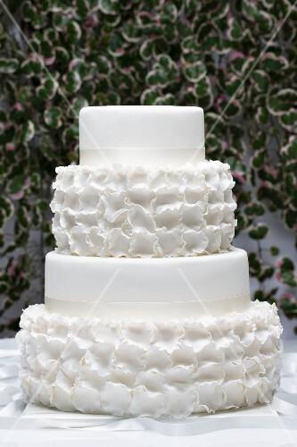 A white, four-tier wedding cake