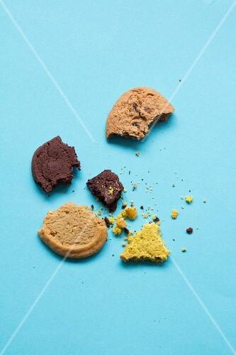 Broken biscuits on a light blue background