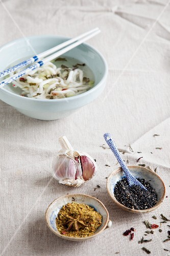 Noodle soup, garlic, spices and sesame seeds (Asia)