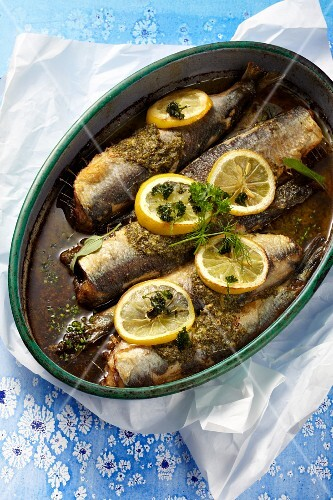Oven-roasted herring with lemon and herb butter