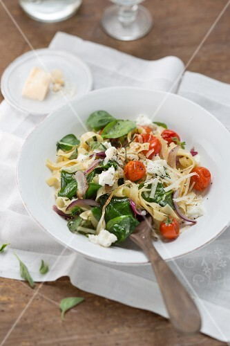 Tagliatelle with cherry tomatoes, spinach, ricotta and Pecorino cheese