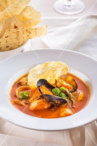 Seafood soup with potato crisps