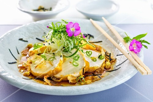 Fried tofu with edible flowers (Asia)