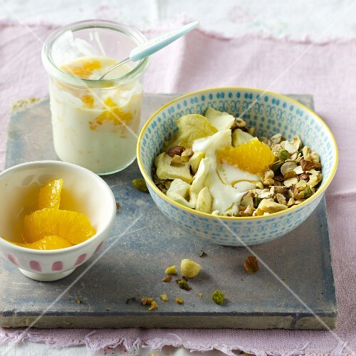 Walnut and pistachio muesli with oranges and soy yoghurt