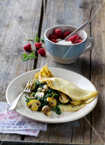 Almond pancakes filled with spinach and mushrooms