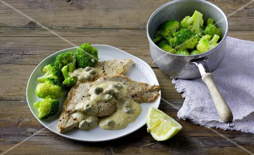 Veal escalope with a caper and cream cheese sauce and broccoli
