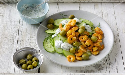 Cucumber carpaccio with chilli prawns and green olives