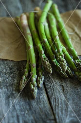 Fresh asparagus on a wooden board