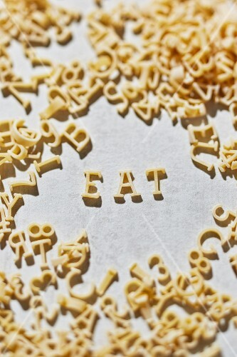 Alphabet pasta spelling the word EAT