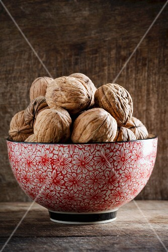 Walnuts in a floral-patterned bowl