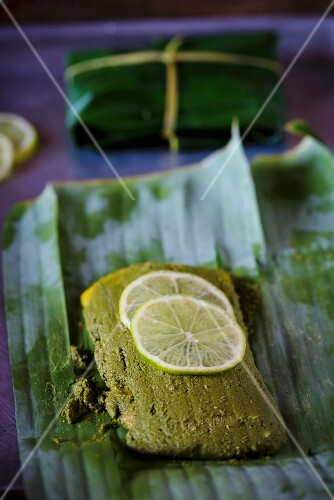 Fish in a herb and chilli marinade wrapped in a banana leaf