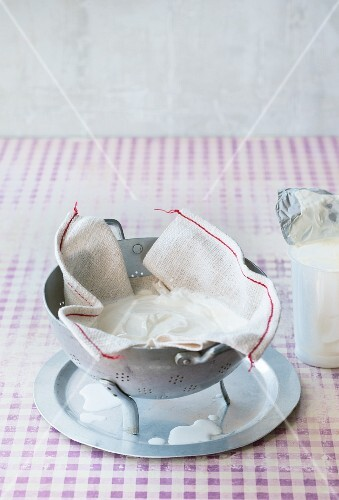 Yoghurt being drained in a muslin cloth