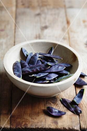 A bowl of purple mange tout