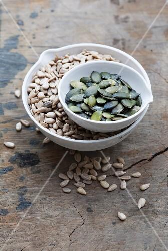 Bowls of sunflower seeds and pumpkin seeds