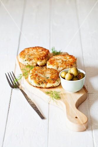 Tuna and potato cakes with fresh herbs and olives