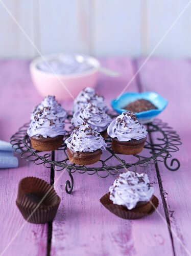 Mini chocolate muffins with purple butter cream