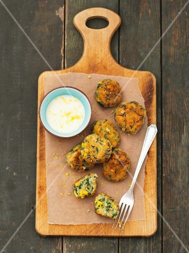 Salmon and sweetcorn balls with spinach and lemon sauce