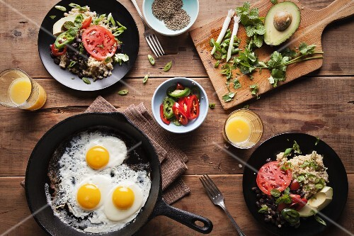 Quinoa salad with black beans, avocado, tomatoes and chilli served with fried eggs
