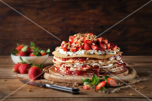 A crepes cake filled with cream cheese, strawberries and strawberry jam