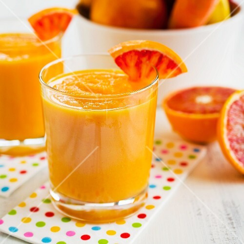 Smoothies made with orange fruits and vegetables