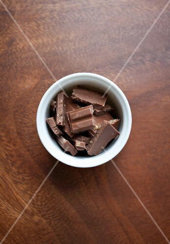 Pieces of chocolate in a porcelain bowl (seen from above)