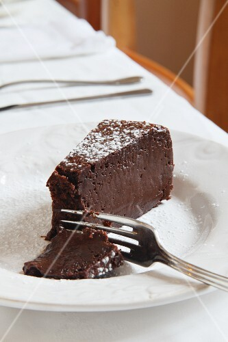 A Slice of Chocolate Cake on a Black Background