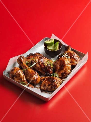 Glazed chicken legs with limes