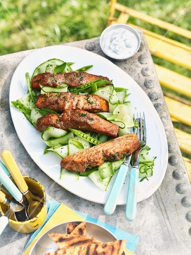 Tandoori salmon on a cucumber and mint salad