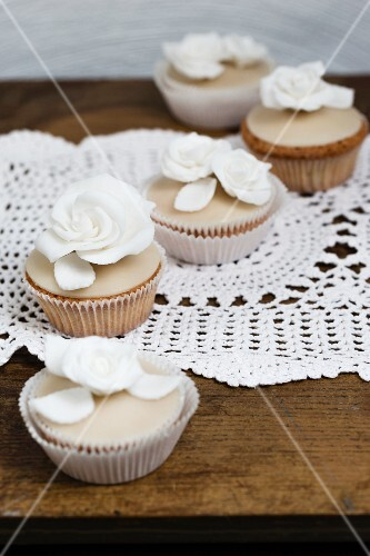 Cupcakes with white sugar roses
