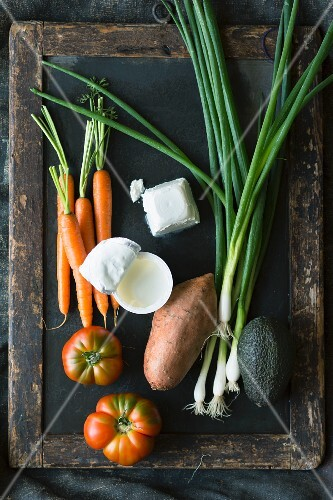 Various types of vegetables with yoghurt and goat's cheese