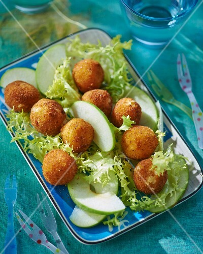 Breaded cheese balls with apple wedges and lettuce