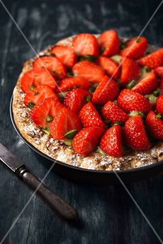 A strawberry tart with pistachios