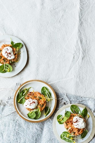Vegetarian carrot and almond tartar on young spinach