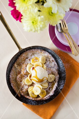 Oven-baked pancakes with banana, rice pudding and honey