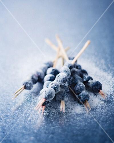 Frozen blueberries on skewers