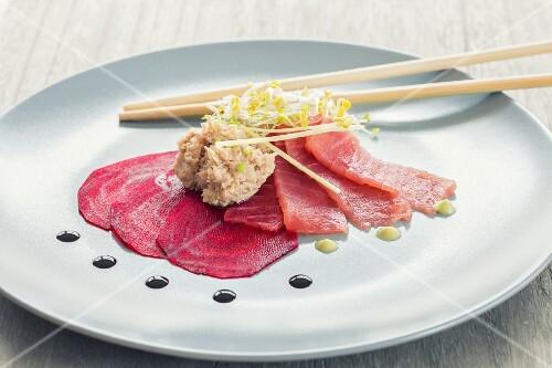 Beetroot carpaccio with a tuna and lemongrass cream, sashimi, wasabi and soy sauce