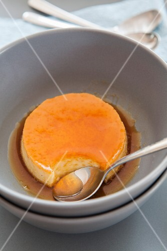 Caramel cream in a bowl with a spoon