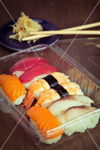 Tuna fish, prawn, salmon and mackerel nigiri in a plastic box