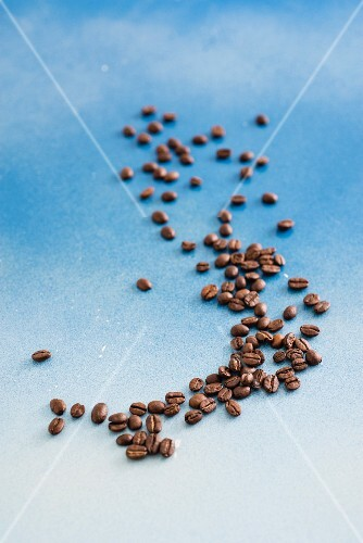 Coffee beans on a blue surface