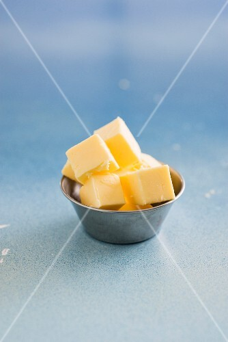 Butter cubes in a metal bowl