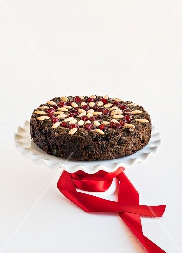 Fruit cake with almonds and glace cherries for Christmas