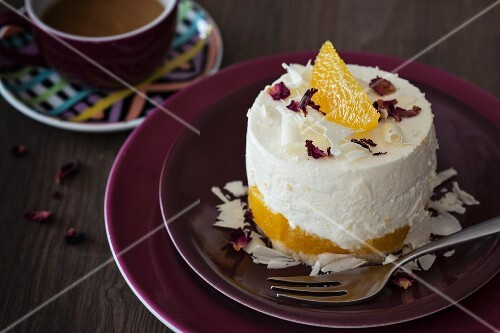 A mini cheesecake with oranges and white chocolate