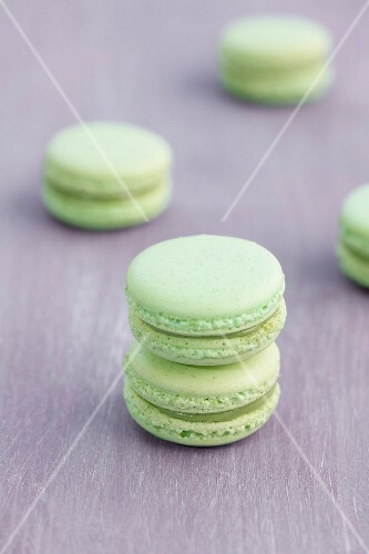 Pistachio macaroons on a wooden surface