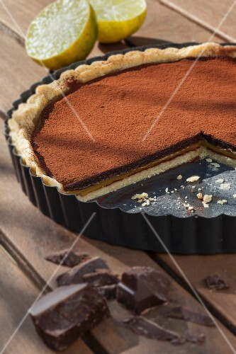 Shortcrust pastry with lemon curd and dark chocolate in a baking tin