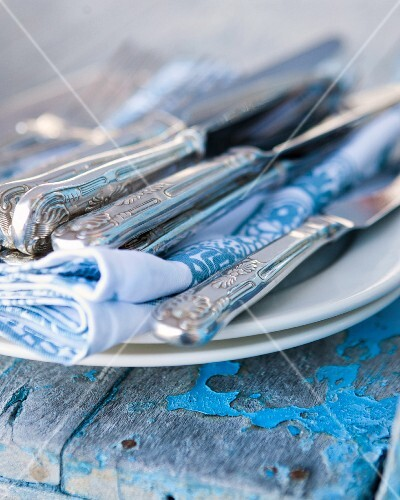 Cutlery with napkins on a plate