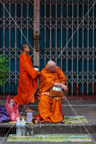 Buddhist monks collecting offerings (Thailand)