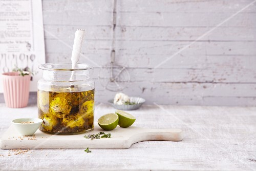 Pickled goat's cheese balls with oregano and charlock seeds